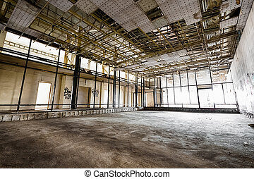 interior of an old abandoned factory building, poor light