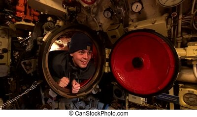 Interior of an old submarine - Guy explores the interior of...