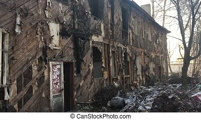 interior of burned house with white window and lots of...