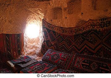 Interior of cave house in tuff rock formation. Historic stone house. Cappadocia, Turkey.