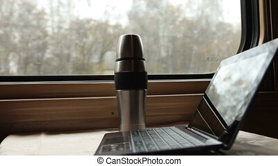 Interior of coupe in passenger train car - tablet computer...