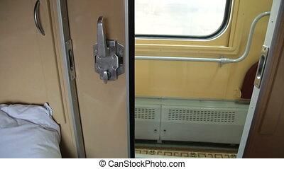 Interior of coupe in ukrainian passenger train car