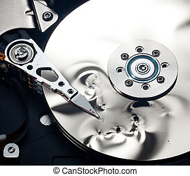 Interior of damaged hard drive - Magnetic disc inside a...