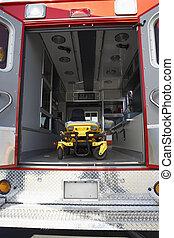 Interior of empty ambulance and gurney