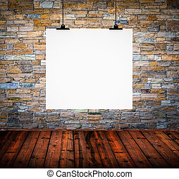 Interior of empty room with white paper hanging on wall