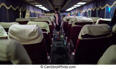 Interior of intercity bus passenger boarding the coach at...
