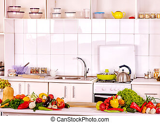 Interior of kitchen with vegetables. - Interior of white ...