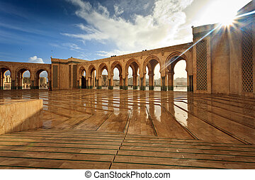 Sparkling marble arcade of Hamman II Mosque on a Sunny Day
