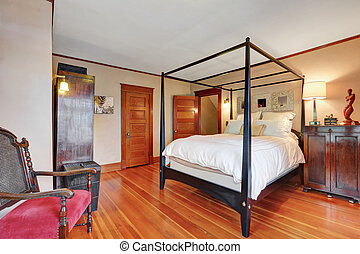 Interior of master bedroom with canopy bed