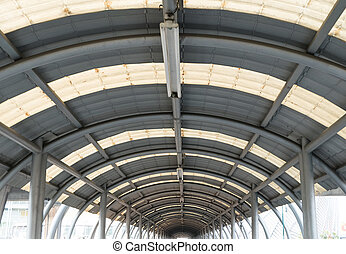 interior of metal roof structure of modern building.