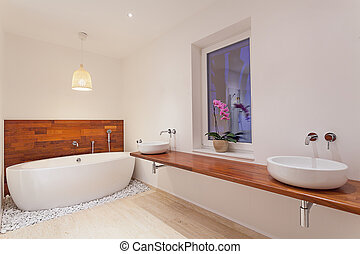 Interior of modern bathroom with window