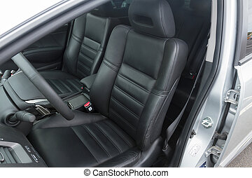 interior of modern car with leather black seats