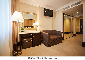 Interior of modern comfortable hotel room.