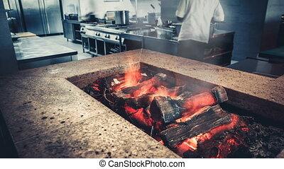 Interior of modern restaurant kitchen, fireplace