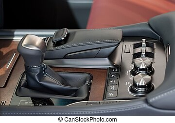 Interior of new modern car with automatic transmission. Passenger compartment finish with genuine leather.