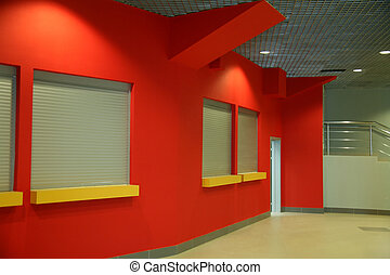 Interior of office building with red wall