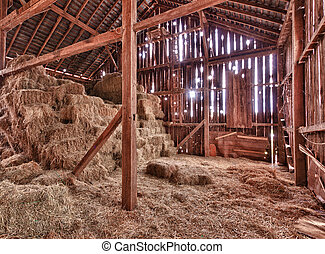Interior of old barn with straw bales - HDR image of an old ...