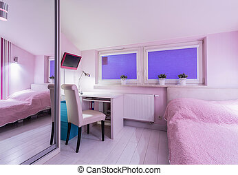 Interior of pink room with bed