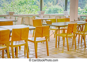 Interior of  restaurant with tables and chair