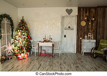 Interior of room with Christmas spruce, festive table and an...