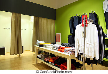 Interior of shop of clothes with fitting rooms