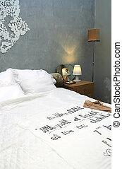 interior of sleeping-room with evening light