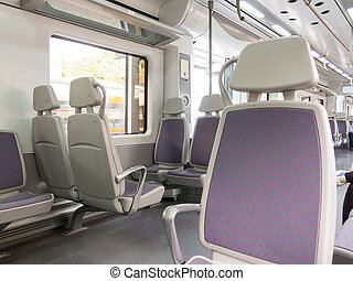Interior of the high-speed train. - Empty seats in train...