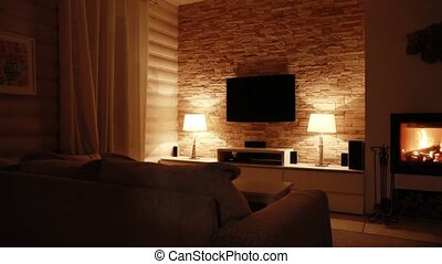 Interior of the living room with a burning fireplace at the ...