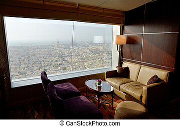 Interior of the luxury hotel with a view on Dubai city, UAE