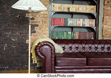 Interior of the room in old style with a leather sofa