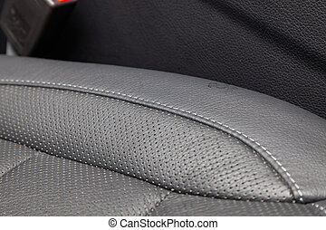 Interior of the SUV car with a rebuilt leather in black color in exchange for the old worn-out interior trim in the workshop for repairing the seat doors and steering wheels