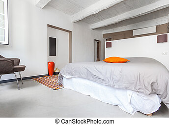 Interior of the white comfortable bedroom.