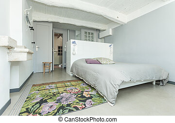 Interior of the white rustic bedroom.
