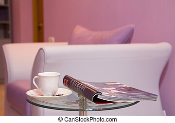 Interior of waiting room. - Purple leather sofa, cup of...