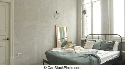 Interior of white and gray cozy bedroom near to white desk...