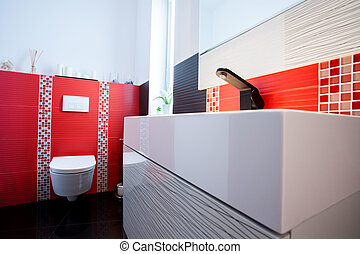 Interior of white and red bathroom