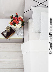 Bedside table decor - Interior of white bedroom, new linens ...