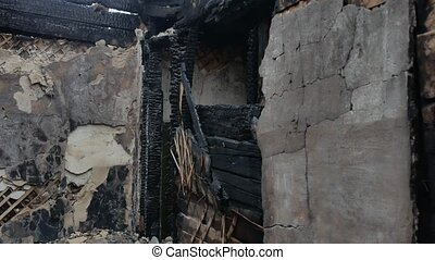interior old burnt fire of burned-down wooden house after -...