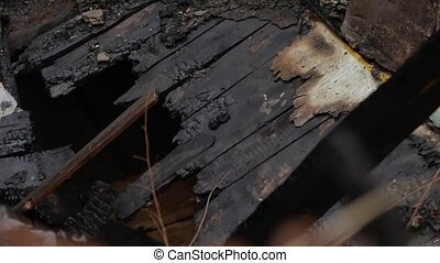 interior old burnt of fire burned-down wooden house after -...