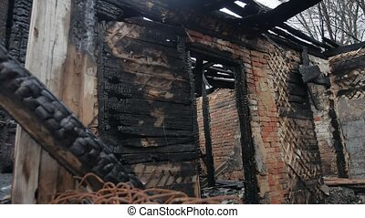 interior old fire burnt of burned-down wooden house after -...