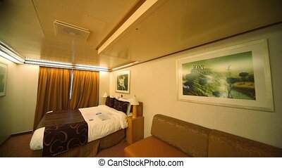 interior passenger cabin bedroom in cruise ship, horizontal panning