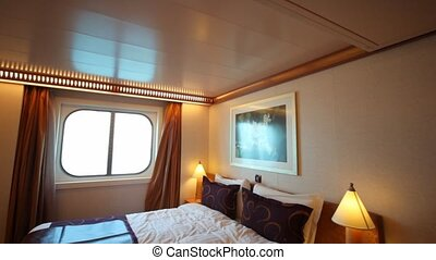 interior passenger cabin bedroom in cruise liner, vertical panning in Persian Gulf.