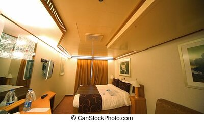 interior passenger cabin bedroom in cruise ship, vertical panning