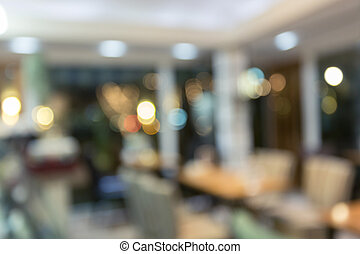 interior restaurant with light glittering in the night, abstract blur image background