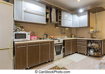 Interior spacious kitchen in a residential apartment
