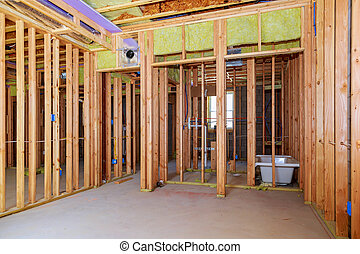 Interior wall framing with piping installation in the basement Bathroom remodel under floor plumbing work