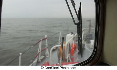 Interior window view of ocean with bow