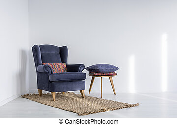 Interior with navy blue armchair