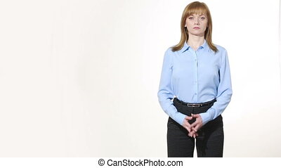 interlaced fingers. girl in pants and blous.  Isolated on white background. body language. women gestures. nonverbal cues