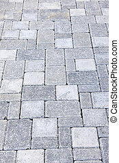 Gray interlocking paving stone driveway from above